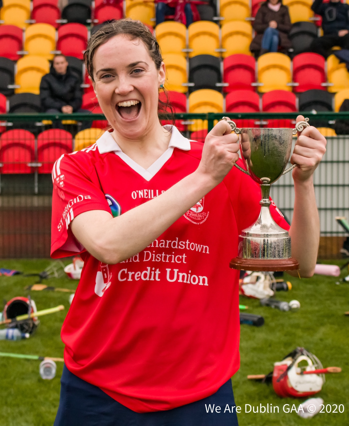 The St Brigids Camogie Captain raises the Junior 3 cup after her side beat Ballyboden St Endas in the final.