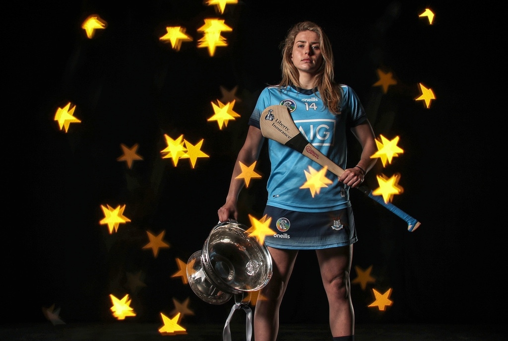 Dublin's Aisling Maher holding the O'Duffy Cup and a hurl at a photo shoot, Maher is looking to secure a All Ireland quarter final spot after recovering from a career ending double leg break