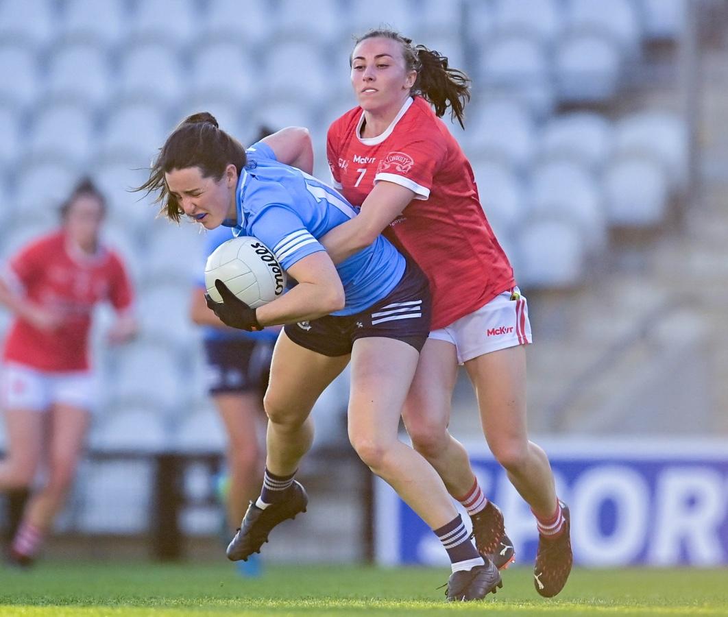 Dublin's Lyndsey Davey is tackled by Cork's Melissa Duggan during their Ladies National Football League game this evening in Páirc Uí Chaoimh