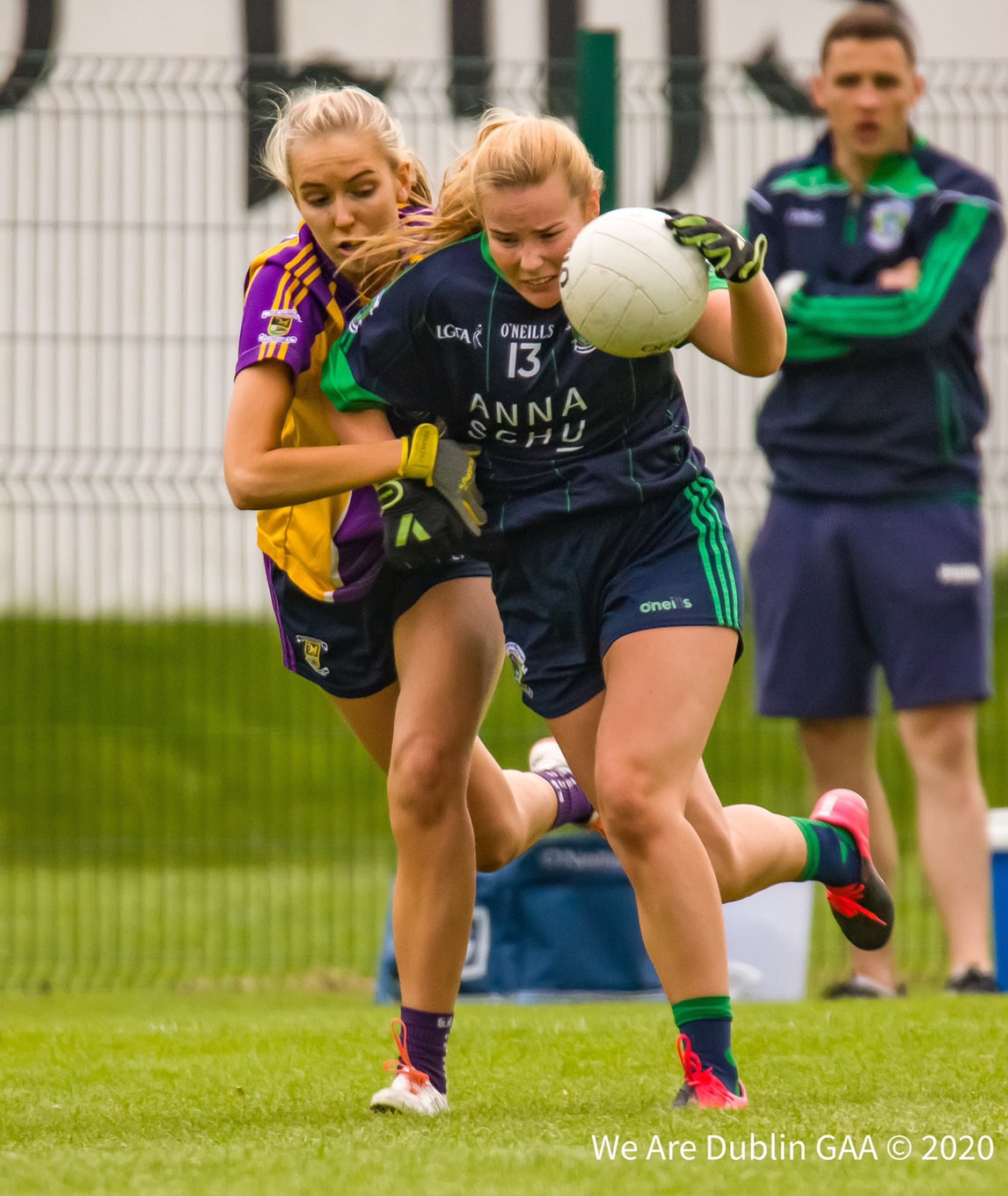 A Foxrock Cabinteely player tries to get away from a Kilmacud Crokes player, both sides meet tonight as ladies football club action returns with the Go-Ahead Ireland Adult Cup Round 1