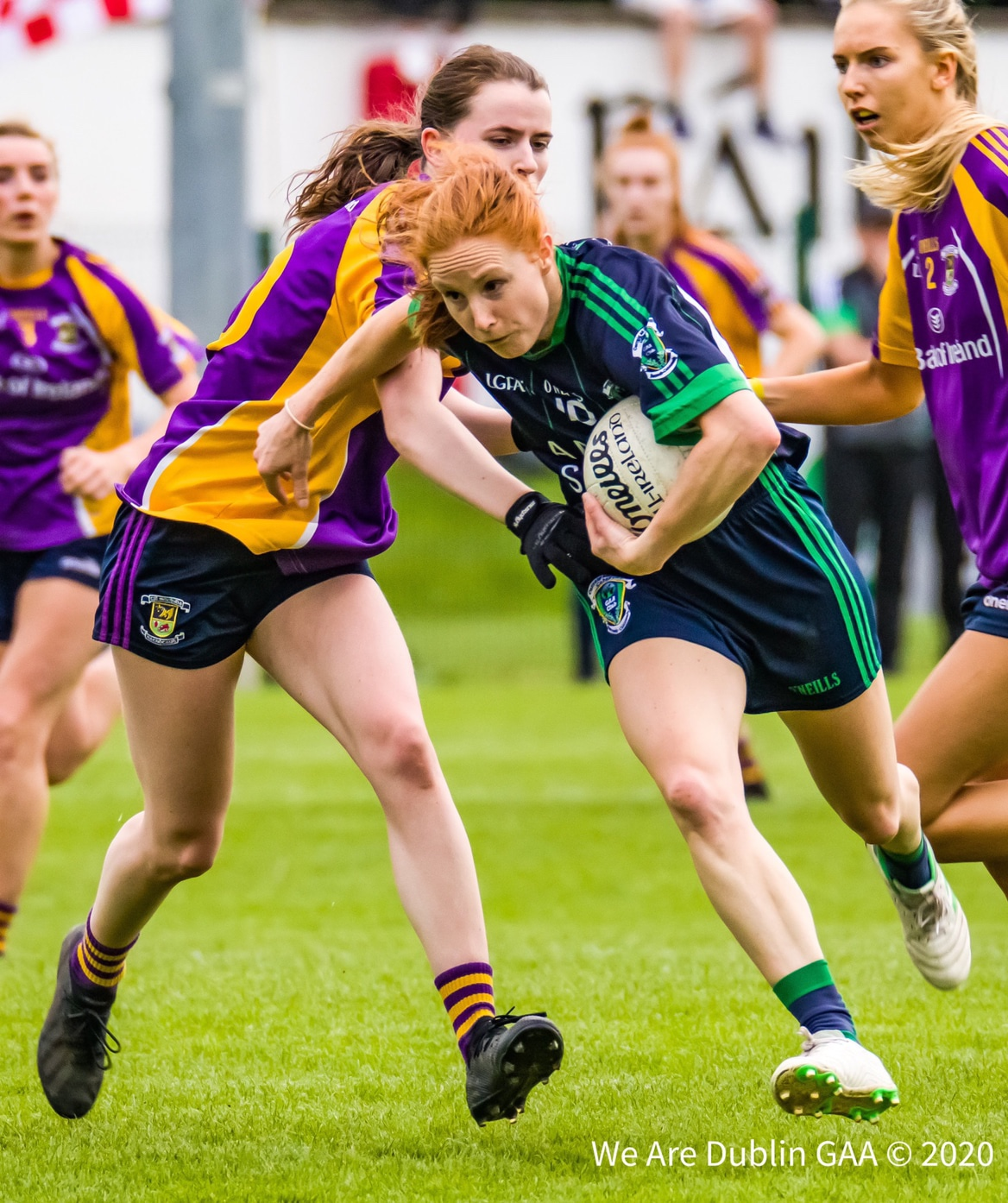 A Foxrock Cabinteely player tries to break away from the attentions of a Kilmacud Crokes player, both sides played out a thriller in the Adult Cup last night with Foxrock finding themselves among the winners as the Adult Cup Round 1 results poured in.