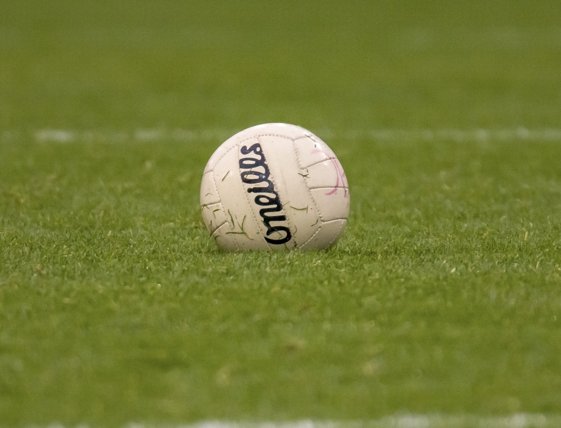 A single ladies Gaelic football on a pitch to signify another Wednesday evening of Dublin ladies football club action with 49 Adult league Round 3 fixtures taking place