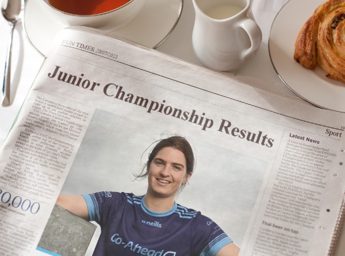 A newspaper on a breakfast table with the headline Junior Championship results, round 2 of the Dublin LGFA Junior Championship took place on Wednesday evening.