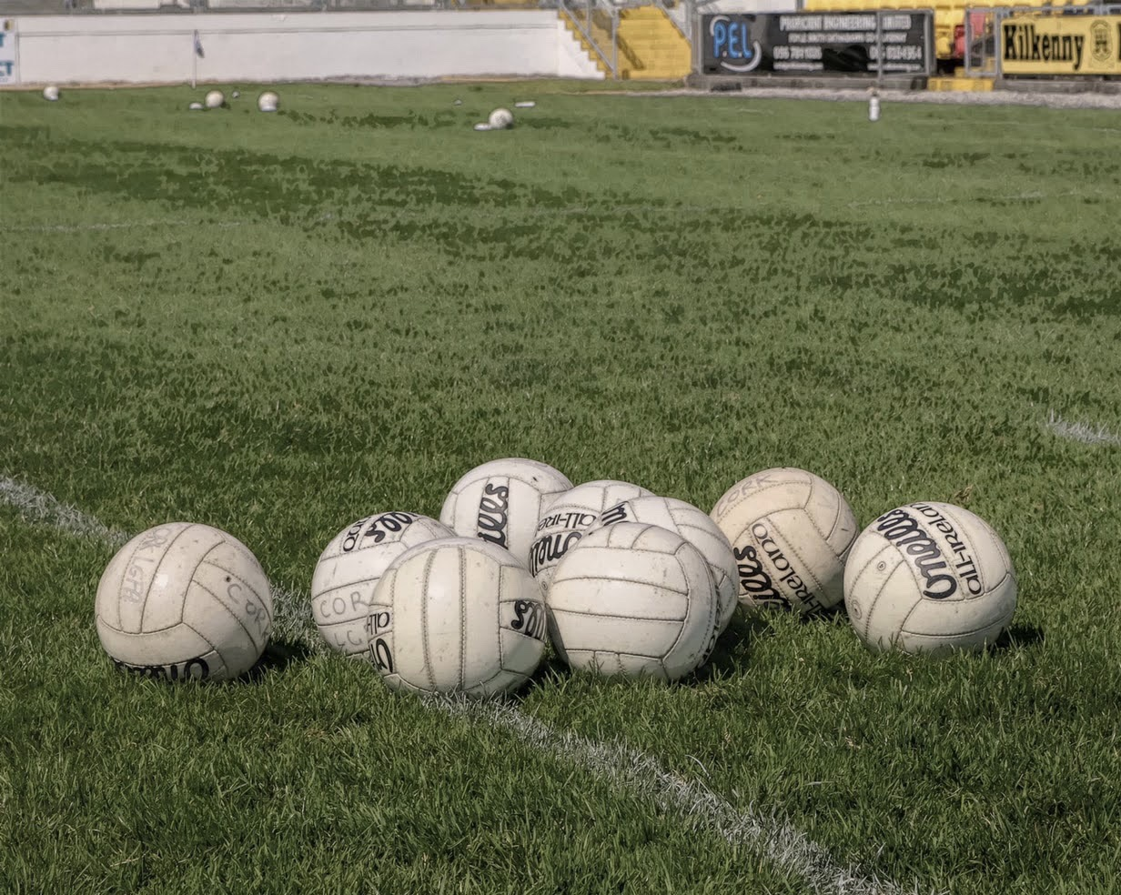 Eight ladies Gaelic footballs on a pitch to signify tonight's Dublin LGFA club championship and adult league games taking place