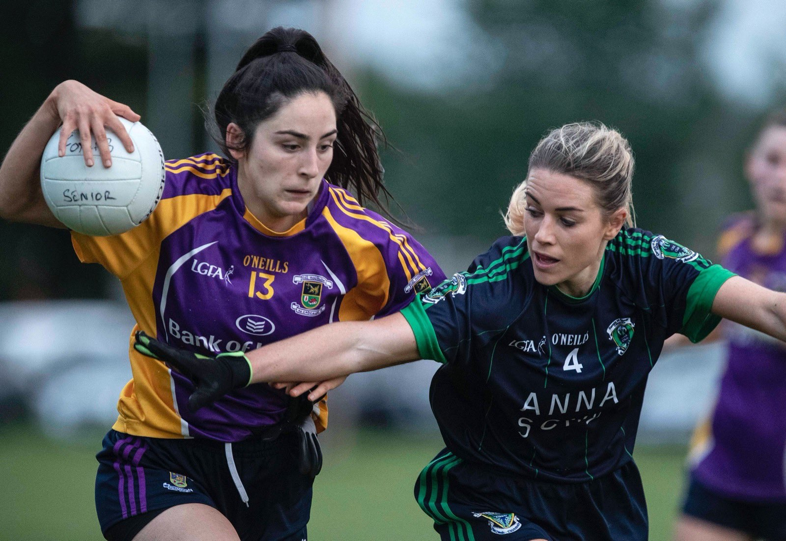 A Kilmacud Crokes player tries to break past a Foxrock Cabinteely player during the opening round of the Dublin LGFA Club Championship