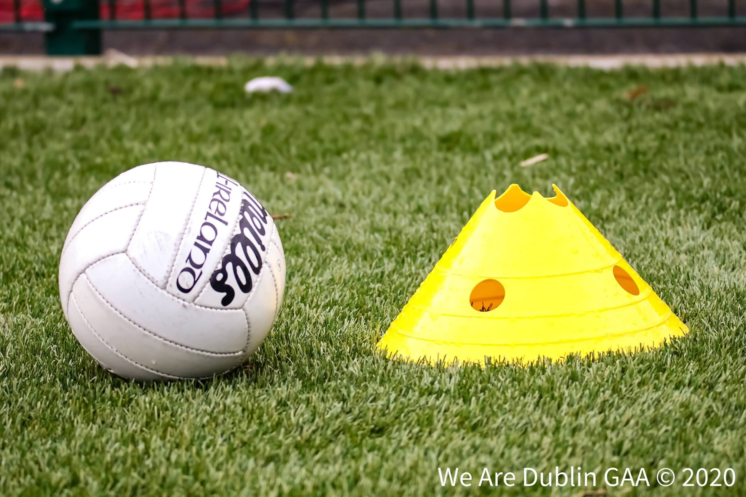 A ladies Gaelic football and cone on a pitch to signify the Dublin LGFA club championship fixtures that are taking place today.