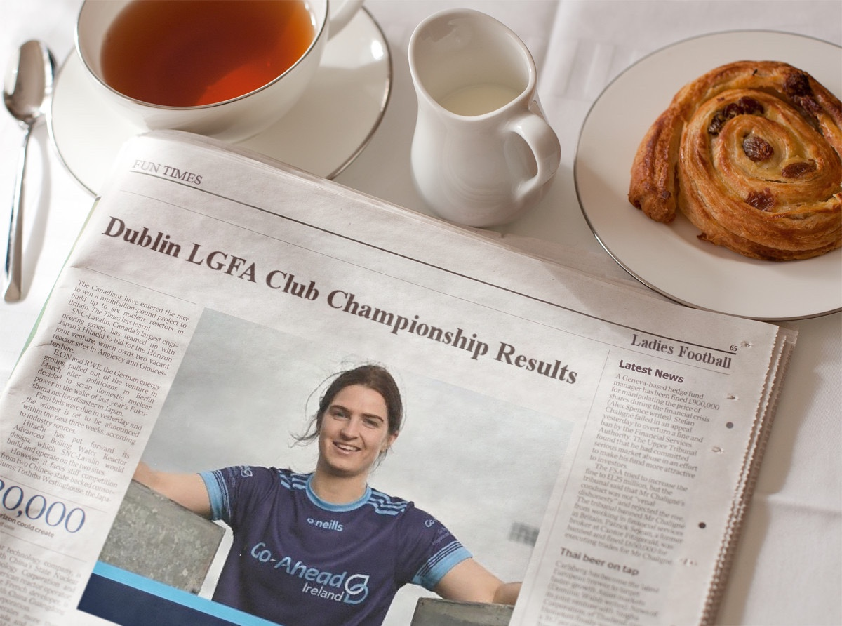 A newspaper on a breakfast table with the headline Dublin Ladies Football Club Championship results